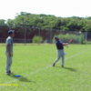 Outfield coach Clayton hitting fungos