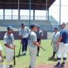 Matt Dickson hitting coach gving instruction