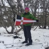 Anne Smith holds the Burgee at 5,500', Christmas Hill on Michael's Birthday, Mt Hotham.