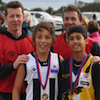 >Junior footballers unite in sportsmanship
